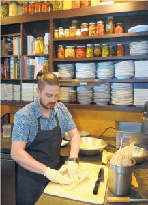 "Chef Sean Sinclair of Farm & Table says he's a big supporter of local food because ""it supports farms & farmers, but it's also what food should taste like."" Here, he prepares spaghetti squash tamales."