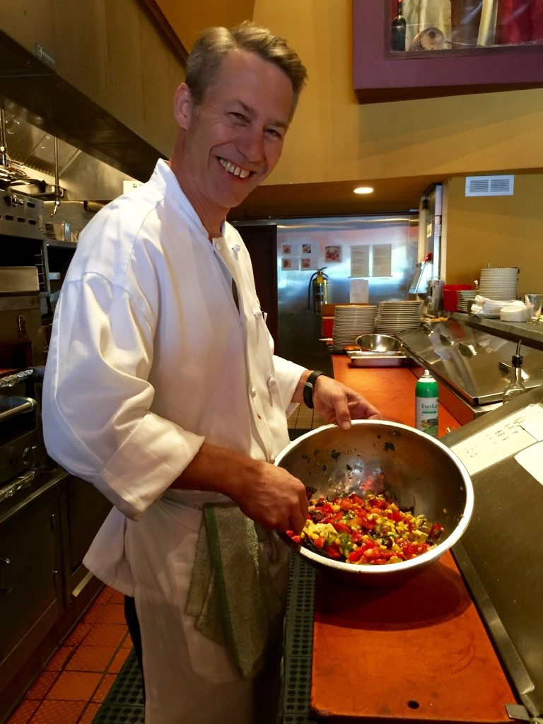 Executive Chef Chris Pope of Zinc Wine Bar Bistro tosses a relish with local tomatoes and corn along with avocado and olives.