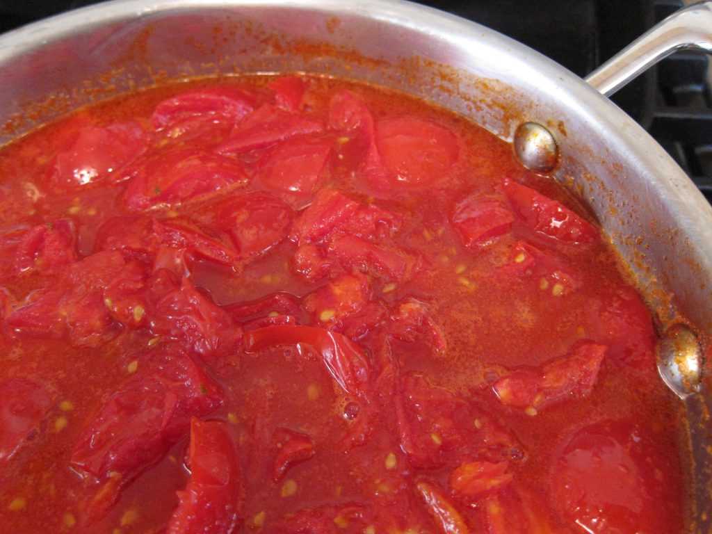 Simmer the tomatoes for about 15 minutes, until they are soft.