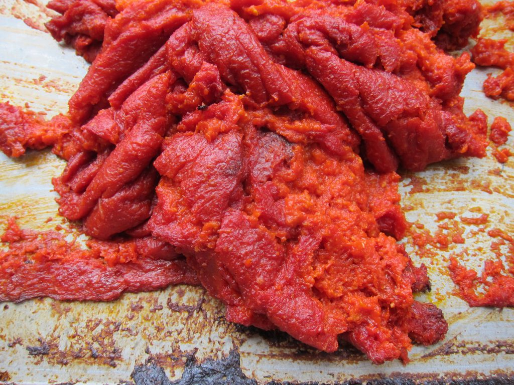 When the tomato paste is thick and brick-colored, the tomato paste is done!