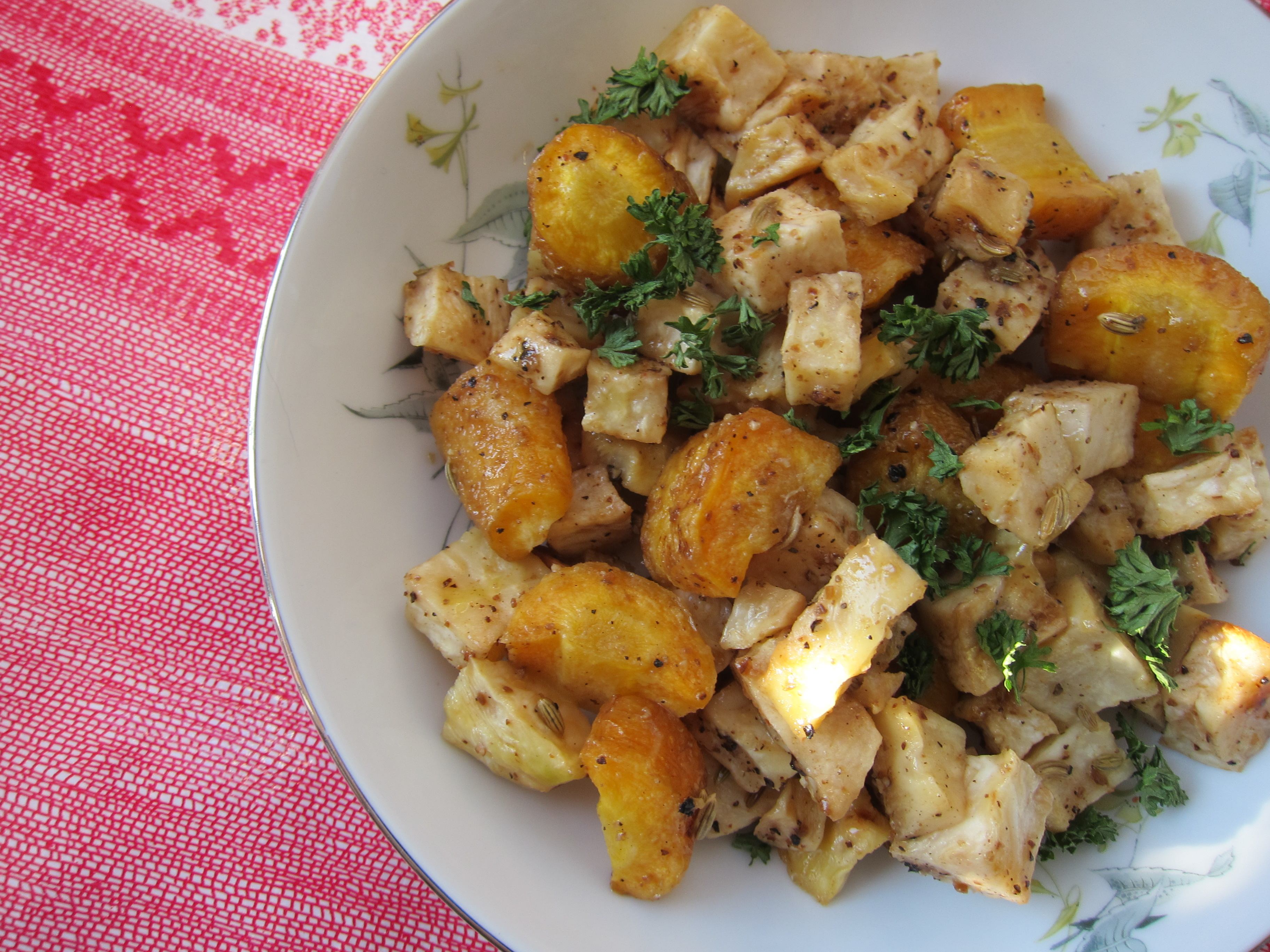 Roasted celery root and sweet carrots makes a perfect winter side dish to roast chicken, delicate white fish, or beef.