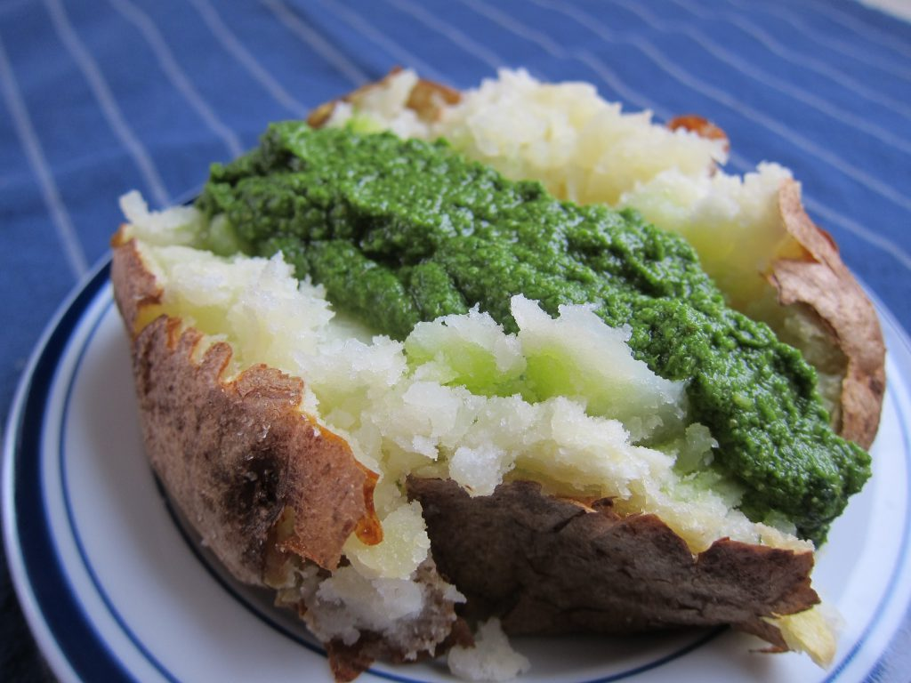 Mixed herb pesto is just as tasty on baked potatoes as grilled chicken.
