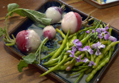 Rattail radishes with greens and tempered butter dipped radishes, bottom, chunky radishes with fresh bread and butter. (Greg Sorber/Albuquerque Journal)
