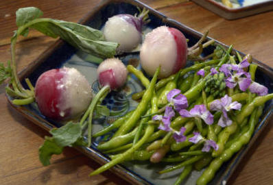 gbs052316s/FOOD -- Rattail radishes with greens and tempered butter dipped radishes, bottom, chunky radishes with fresh bread and butter. (Greg Sorber/Albuquerque Journal