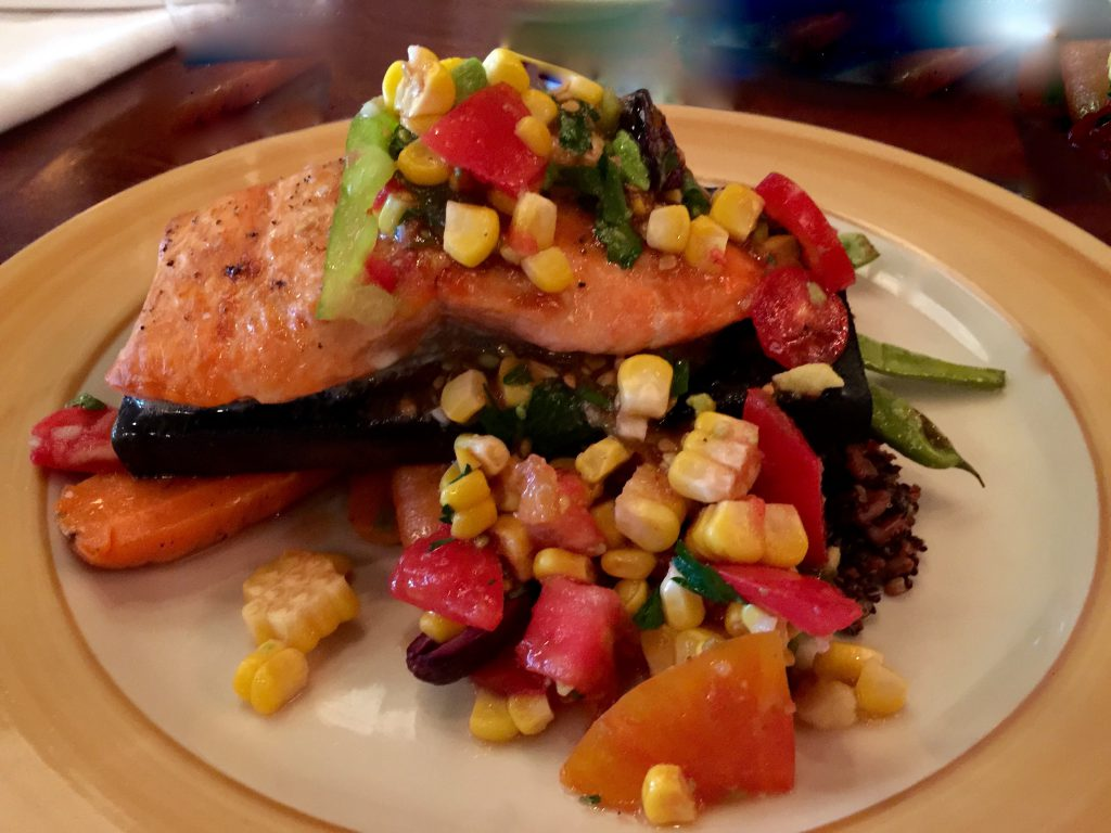Cedar plank salmon, quinoa and rice pilaf with string beans and carrots, topped with fresh relish. (Denise Miller/For the Albuquerque Journal)