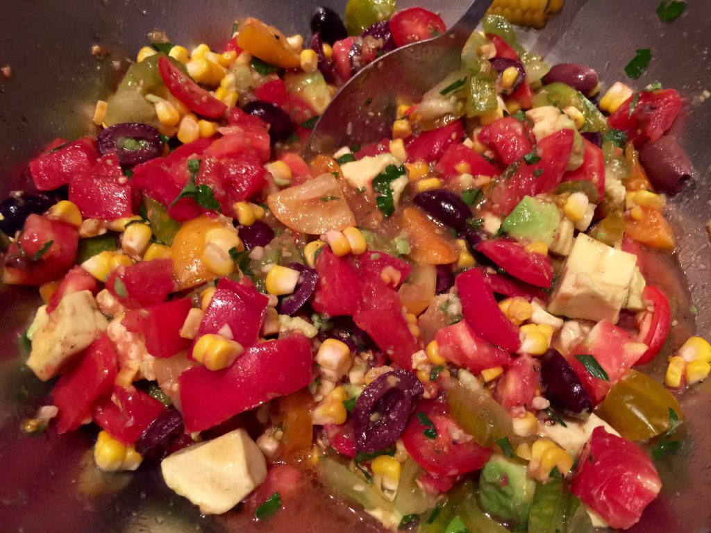 Corn, tomato, avocado and olive relish uses orange zest and juice to draw out the fresh flavor of the vegetables. (Denise Miller/For the Albuquerque Journal)