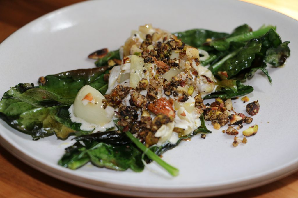 Grilled whole-leaf spigarello with shallot-yogurt dressing and toasted pistachios.